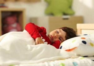 Toddler Asleep in Bed