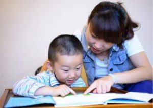 Parent Teaching Toddler to Read