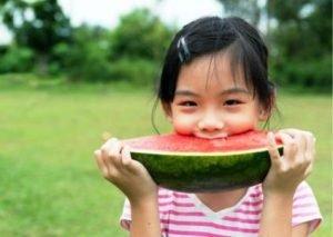 Girl Eating Healthily Watermelon